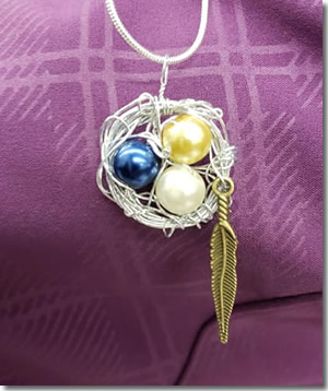 wire birds nest charm photo by Katie Bloor