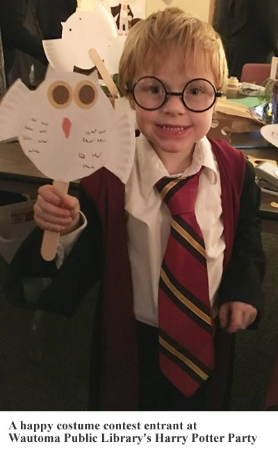 A happy costume contest entrant at Wautoma Public Library's Harry Potter Party