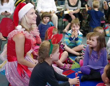 photo of Fairy Jasmine visiting Xmas storytime for face painting and craft