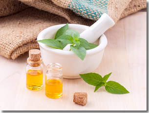 mortar and pestle, essential oils, and mint for aromatherapy
